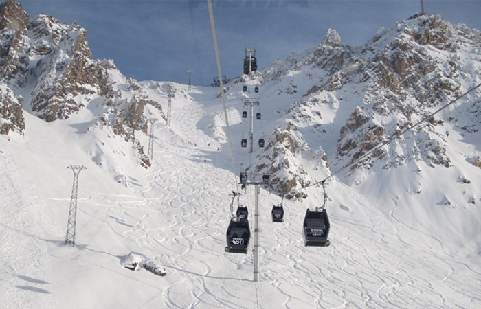 A gondola on a snowy mountain in Courchevel France