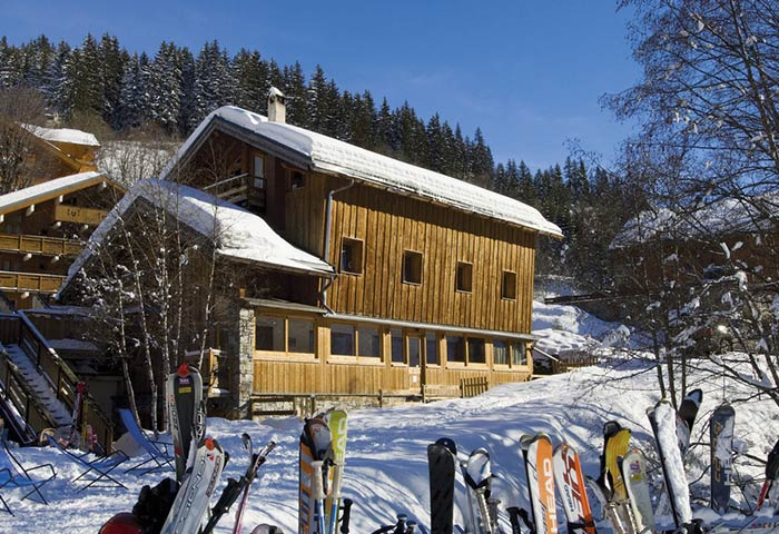 Chalet La Boua on a snowy sunny day in Meribel France