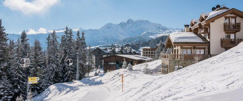 The Lodge ski in ski out chalet in Courchevel France on a sunny winter day