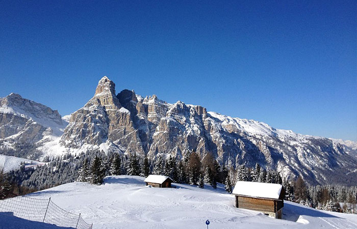 Corvara mountains and ski resort in Italy on a sunny bluebird day
