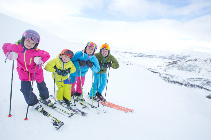 family skiing in norway