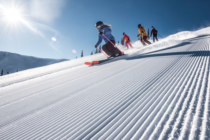 Kids-Skiing-On-The-Piste-With-A-Ski-Instructor