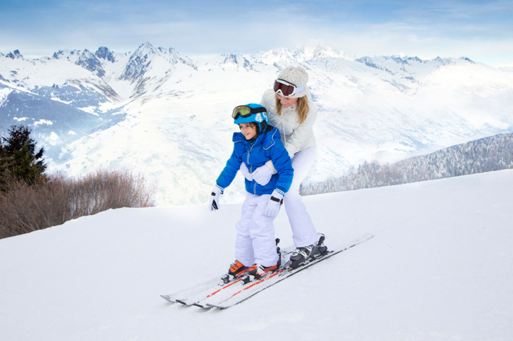Mother-And-Child-Skiing-Together