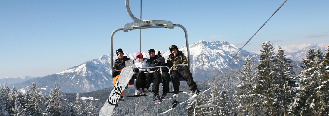 Snowboarders on lift