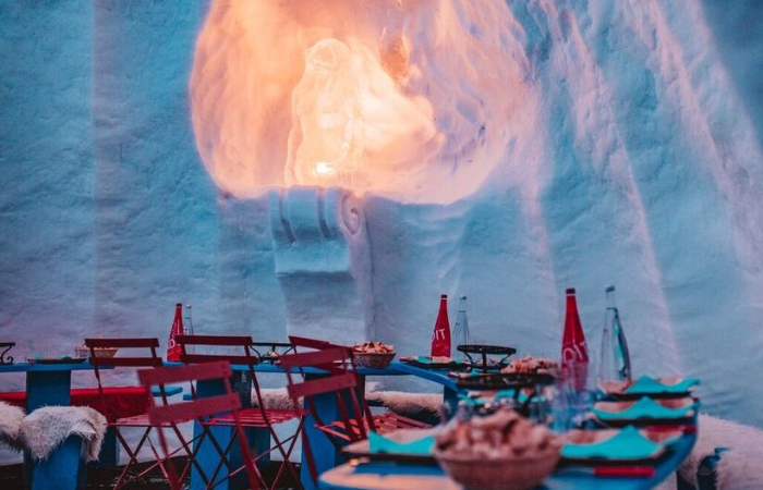 Dine on cheese fondue in Val Thorens' Igloo Village