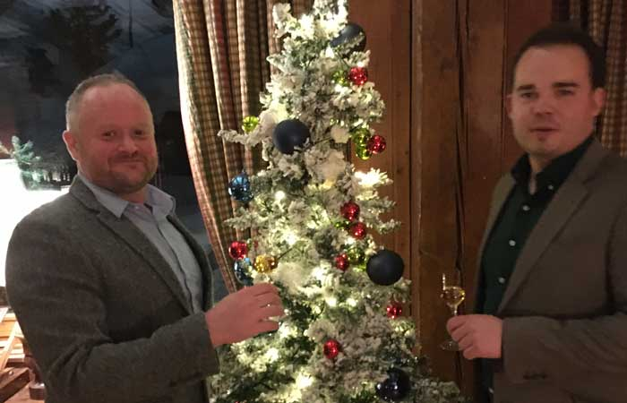 Andy and Joel by the Christmas tree at The Hermitage