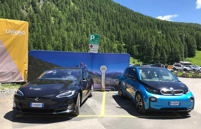 Electric cars driving to the Alps